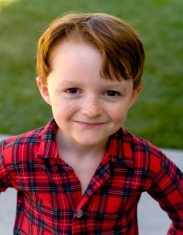 stock-photo-4221110-boy-redhead-child-freckle-face-button-down-shirt-christmas-morning